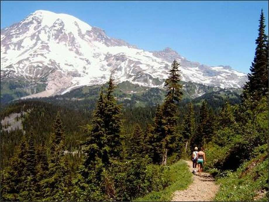 Descending the trail from Pinnacle Saddle's 6,000-foot elevation, hikers enjoy a spectacular view of Mount Rainier and surrounding peaks. This hike is just the right length for beginners and hikers with small children. Photo: KAREN SYKES