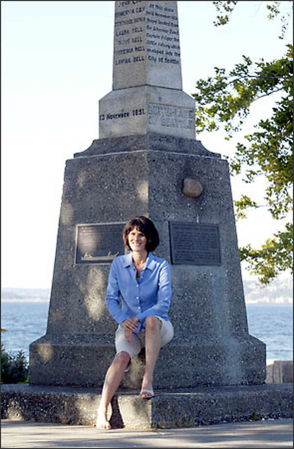 Amy Johnson, the great-great-great-granddaughter of Seattle pioneer David Denny, one of the original white settlers who arrived in 1851, sits at the Alki Point historic marker marking the birthplace of Seattle. Photo: Dan DeLong/Seattle Post-Intelligencer