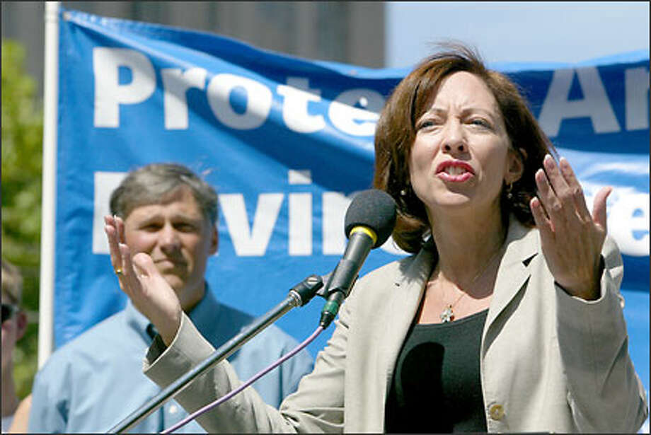 """Sen. Maria Cantwell was joined by Rep. Jay Inslee, background, in rallying a Westlake Plaza crowd of about 100. Cantwell questioned whether we """"need roads in every corner of our national forests."""" Photo: Karen Ducey/Seattle Post-Intelligencer"""