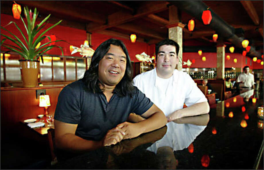 Executive chef Eric Tanaka, left, winner of the James Beard award for Best Chef Northwest/Hawaii, and chef Mark Fuller have helped make the stylish Dahlia Lounge popular. Photo: Joshua Trujillo/Seattle Post-Intelligencer