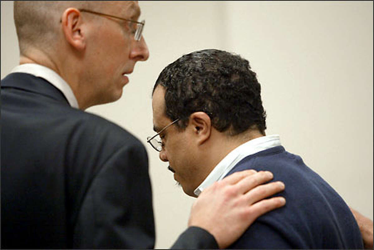 Ronald Matthews is consoled by his defense attorney, Russell Leonard, after hearing of his aggravated murder conviction.