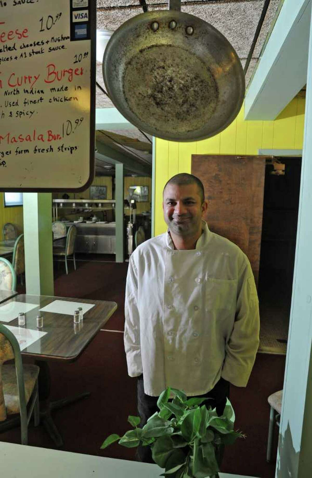 Faisal David Khan stands in his restaurant Burger Centric in Albany, NY on Thursday, March 10, 2011. (Lori Van Buren / Times Union)