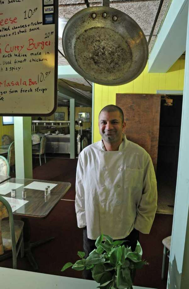 Faisal David Khan stands in his restaurant Burger Centric in Albany, NY on Thursday, March 10, 2011. (Lori Van Buren / Times Union) Photo: Lori Van Buren