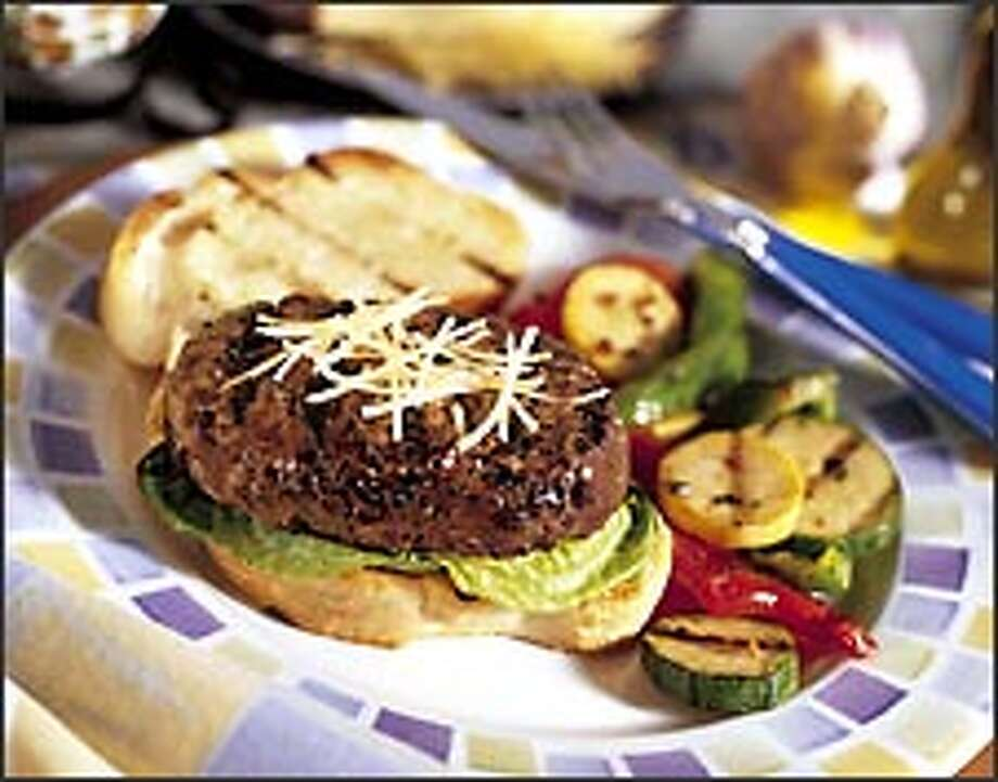 Caesar Salad Beef Burgers on Garlic Crostini are made with lean beef, for a low-fat but stylish burger. This flavorful creation, just sizzling with pizzazz, is from a recipe by the National Cattlemen's Beef Association. Photo: AP / NATIONAL CATTLEMEN'S BEEF ASSOCI