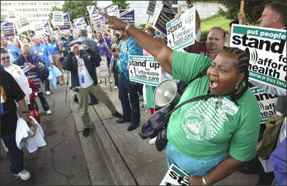 Althea Lute of the Washington Federation of State Employees rallies the crowd yesterday at Group Health's Specialty Center in Tacoma. Photo: JOSHUA TRUJILLO/P-I