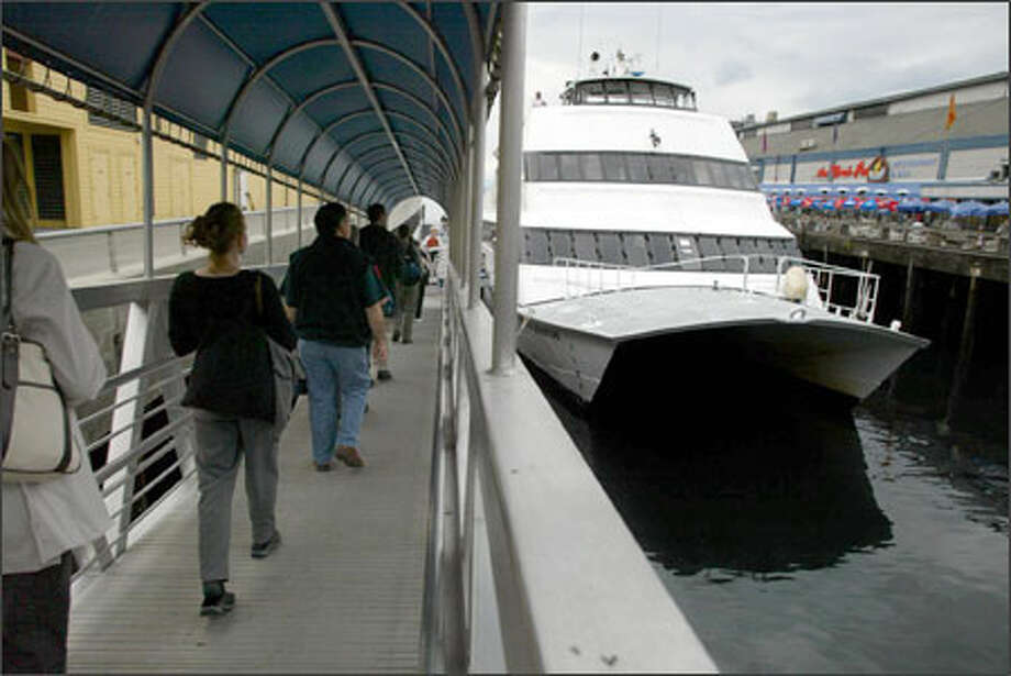 The Kitsap Ferry Co. offers passenger-only service between Seattle and Bremerton. Here, passengers board the Spirit of Adventure recently at Seattle's Pier 56. Photo: Gilbert W. Arias/Seattle Post-Intelligencer