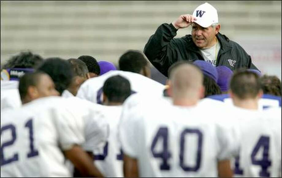 Keith Gilbertson's loyalty to the UW, in full evidence in 2003, should have bought him time to build his own program. Photo: Joshua Trujillo/Seattle Post-Intelligencer