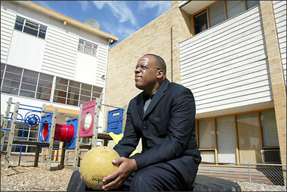 Pastor Craig Jackson, founder of Vision Preparatory Academy in Renton, background, is searching for money to reopen the school, which closed in June because it couldn't pay the $10,000 in monthly rent. Photo: Meryl Schenker/Seattle Post-Intelligencer