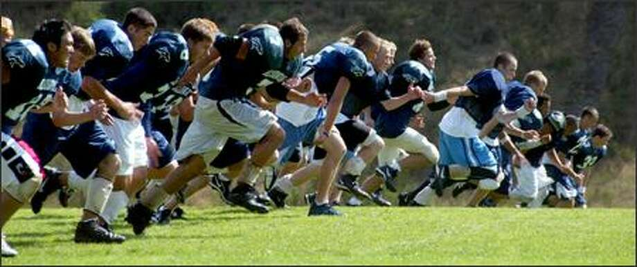 Meadowdale players run 100-yard sprints in preparation for tomorrow night's season opener against Wesco 4A rival Kamiak. Meadowdale suffered a 28-25 loss to the Knights last season. Photo: Grant M. Haller/Seattle Post-Intelligencer
