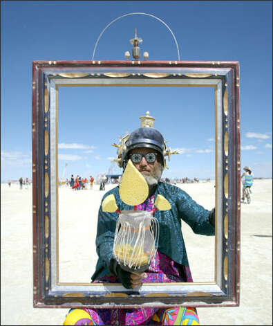 At Black Rock City, Nev., performance artist Al Barney of Olympia works a one-man game show called The Admiral Fuzz Bucket Video Game. There are no set rules, and every game is guaranteed to be different. Photo: Gilbert W. Arias/Seattle Post-Intelligencer