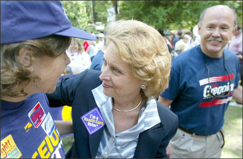Christine Gregoire is greeted by supporters at the King County Labor Council's Labor Day picnic yesterday. At right is her husband, Mike. Photo: Dan DeLong/Seattle Post-Intelligencer