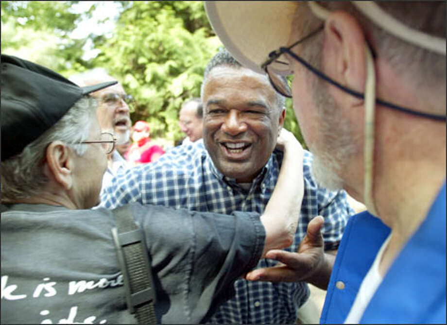 Gubernatorial candidate Ron Sims is greeted by supporters yesterday at the King County Labor Council's Labor Day Picnic at Woodland Park. Photo: Dan DeLong/Seattle Post-Intelligencer