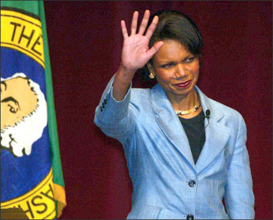 National Security Adviser Condoleezza Rice waves to the crowd at the UW's Meany Hall. Her speech was sponsored by the World Affairs Council. Photo: Grant M. Haller/Seattle Post-Intelligencer