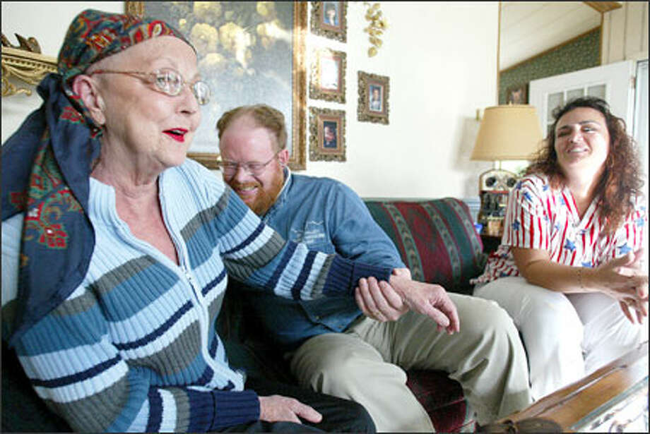 Dr. Mark Raney and medical assistant Karen Clark make a house call on Judy Perkins, who has brain cancer. Raney and Clark are on staff at Sky Valley Family Medicine in Sultan, which was threatened with closure until patients, doctors and others decided otherwise. Photo: Paul Joseph Brown/Seattle Post-Intelligencer