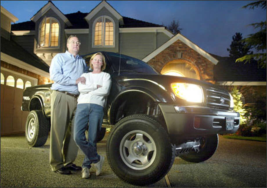 Dan and Suellen Taylor pose at their home on Mercer Island with the shiny 1998 Toyota Tacoma pickup they bought from a dealer in Everett for their 17-year-old son Monday. The deceptively pretty truck proved to be unsafe to drive because of accidents and shoddy repair work. Photo: Joshua Trujillo/Seattle Post-Intelligencer