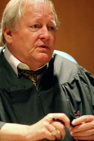 FOR METRO - Municipal Judge David K. Colwell talks with spring breakers who spent the night in jail, most for public intoxication, Tuesday March 15, 2011 on South Padre Island, Tx.   (PHOTO BY EDWARD A. ORNELAS/eaornelas@express-news.net) Photo: EDWARD A. ORNELAS, SAN ANTONIO EXPRESS-NEWS / SAN ANTONIO EXPRESS-NEWS NFS