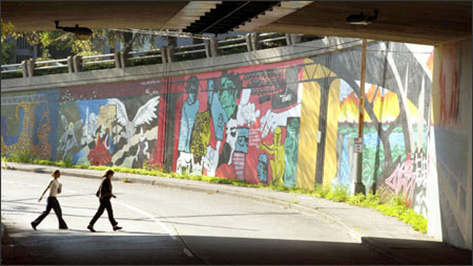 Artwork that brightens a stretch of wall along Northeast Campus Parkway in the University District may have to be altered to satisfy the city of Seattle. Photo: Mike Urban/Seattle Post-Intelligencer