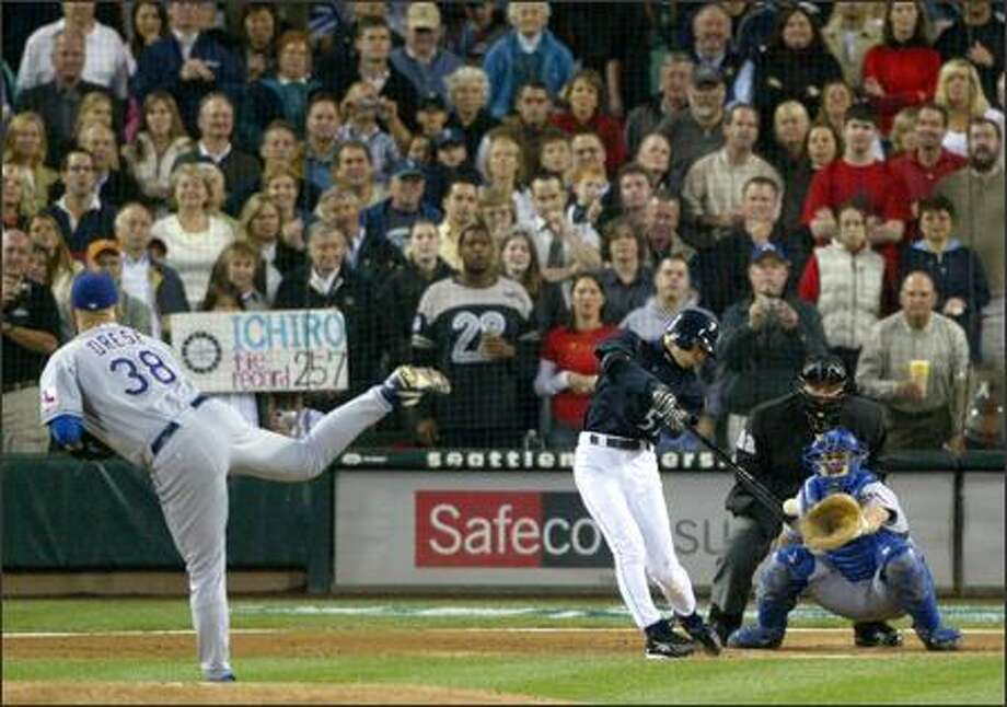 Ichiro Suzuki leads off the third inning by driving his record-breaking 258th hit of the season up the middle for a single off Texas pitcher Ryan Drese.  See more photos from this historic game. Photo: Mike Urban/Seattle Post-Intelligencer