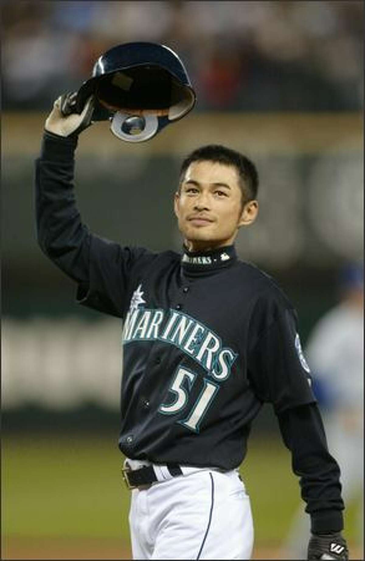 Ichiro Suzuki tips his helmet to cheering fans at Safeco Field last night after breaking the record for hits.See more photos from this historic game.