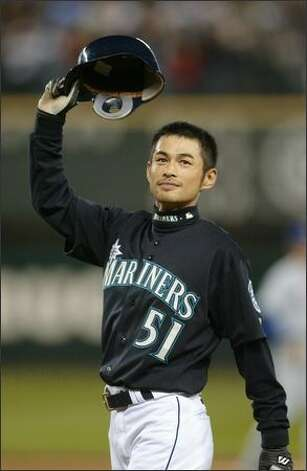 Ichiro Suzuki tips his helmet to cheering fans at Safeco Field last night after breaking the record for hits.See more photos from this historic game. Photo: Joshua Trujillo/Seattle Post-Intelligencer