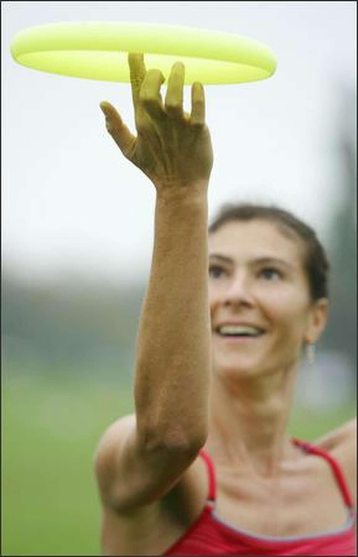 Lisa Hunrichs Silvey of Seattle is the No. 1 ranked women's freestyle disc player in the world; She holds eight championship titles.