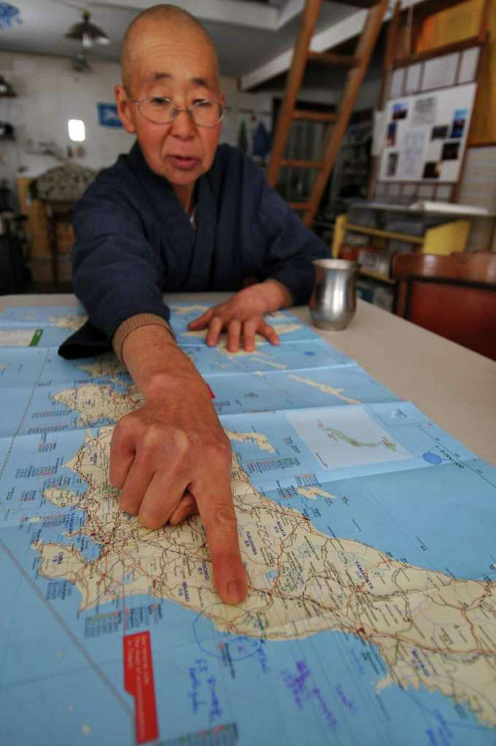 Buddhist nun Jun Yasuda talks about the crisis in Japan caused by the earthquake and tsunami, while looking at a map of the country at the Grafton Peace Pagoda on Tuesday March 15, 2011 in Grafton, NY. The area where the crippled nuclear power plant is located is circle on the map. She grew up in Tokyo. ( Philip Kamrass / Times Union )