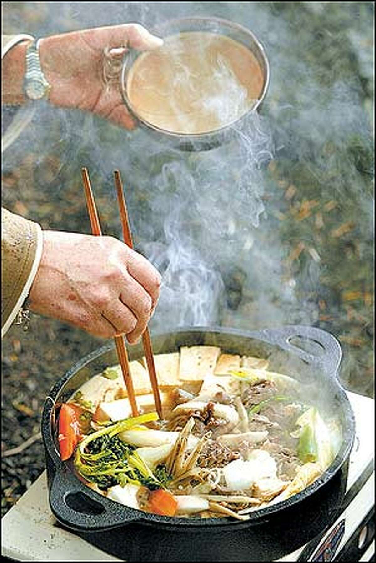 Hiroko Sugiyama makes sukiyaki from freshly picked Matsutaki mushrooms and other ingredients.