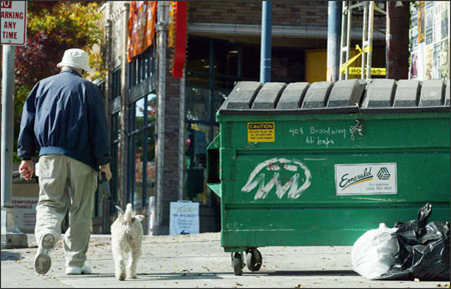 The smallest things can make a big difference in improving urban living, such as removing trash containers. This one is on East Harrison Street at Broadway East. Photo: Paul Joseph Brown/Seattle Post-Intelligencer