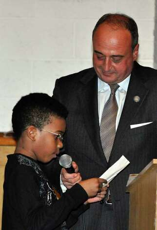 Emcee Lawrence Cafero, Jr. holds the microphone for Zane Brown, a third grader at Brookside Elementary School, as he reads a letter he wrote during the Courage to Speak Empowering Youth to be Drug Free Family Night at West Rocks Middle School in Norwalk on Tuesday, Mar. 15, 2011. Photo: Amy Mortensen / Connecticut Post Freelance