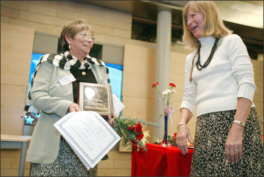 Cecile Hansen, left, longtime chairwoman of the Duwamish Tribe, receives a Spirit of America Award from awards co-chairwoman Pam Schell at City Hall on Thursday. She was honored for her work to gain tribal recognition. Four others received awards from the Ethnic Heritage Council and World Television Photo: Joshua Trujillo/Seattle Post-Intelligencer / Seattle Post-Intelligencer