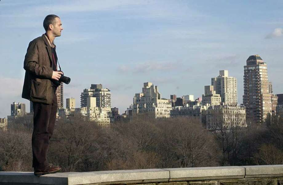 New York Times staff photographer Tyler Hicks stands on a wall at Belvedere Tower in New York City's Central Park in 2004. Photo: File Photo\Kerry Sherck / Stamford Advocate File Photo