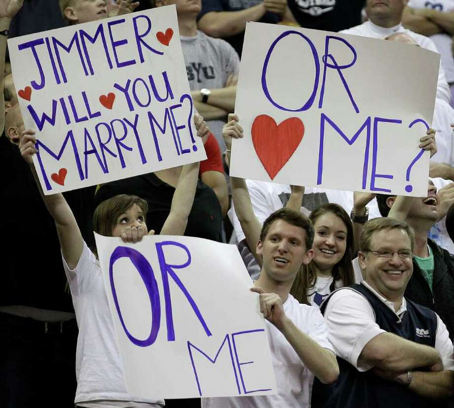 BYU fans hold up signs during the second half of an NCAA college basketball game against New Mexico in the semifinals of the Mountain West Conference tournament, Friday, March 11, 2011, in Las Vegas. Jimmer Fredette scored 52 points in BYU's 87-76 win. (AP Photo/Julie Jacobson) Photo: Julie Jacobson / AP