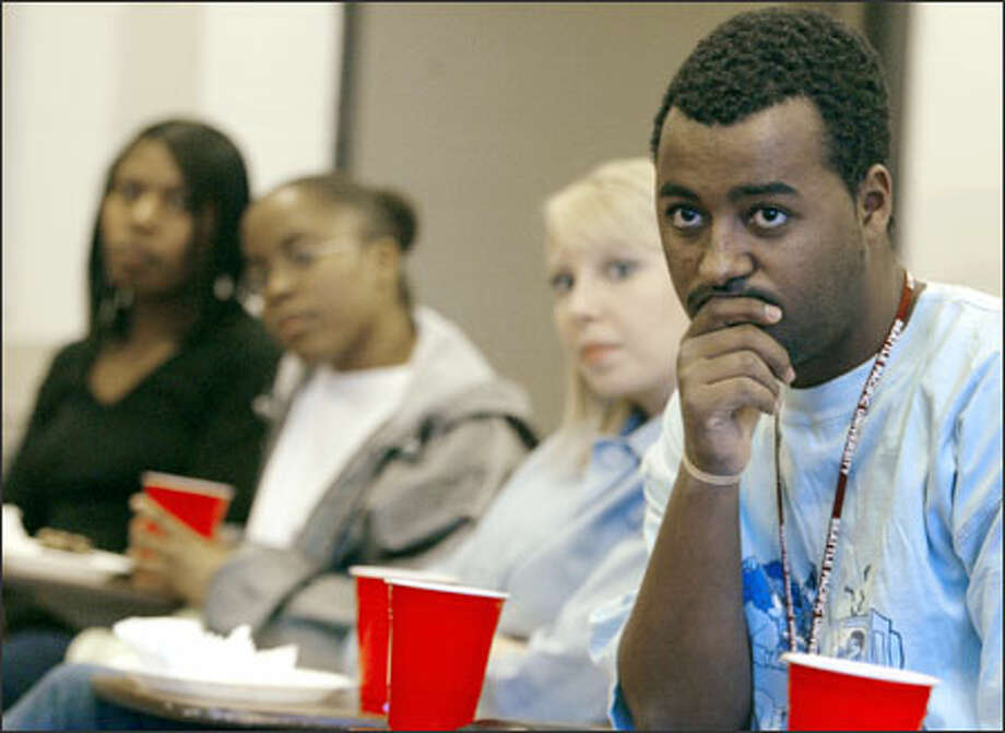 Freshman Elijah Wallace and sophomore Crystal Slyter listen during a Mosaic group meeting on multicultural issues at the SPU campus yesterday. Photo: Meryl Schenker/Seattle Post-Intelligencer