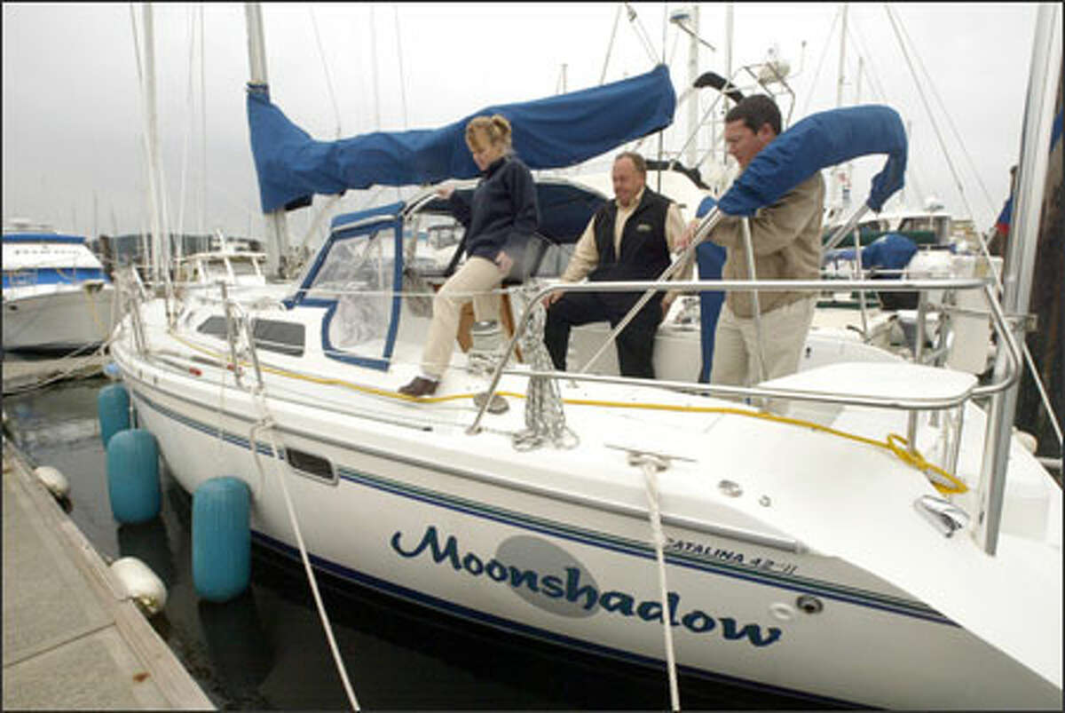 Gary White lost a legal battle over his sailboat, Moonshadow, in U.S. Tax Court. Shown aboard the boat are Kristin Lovell, Dan Meyer and Mike Lovell, all of Anacortes Yacht Charter. Many boat owners have declared their boats second homes, reaping huge tax breaks.