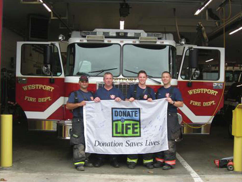 """Members of the Westport Fire Department show their support for Donate Life Connecticut. Firefighters Joseph Arnson and Peter Janulis recently launched """"Firefighters Going Further,"""" a program that encourages people to sign up and become organ and tissue donors. Photo: Contributed Photo / Westport News"""