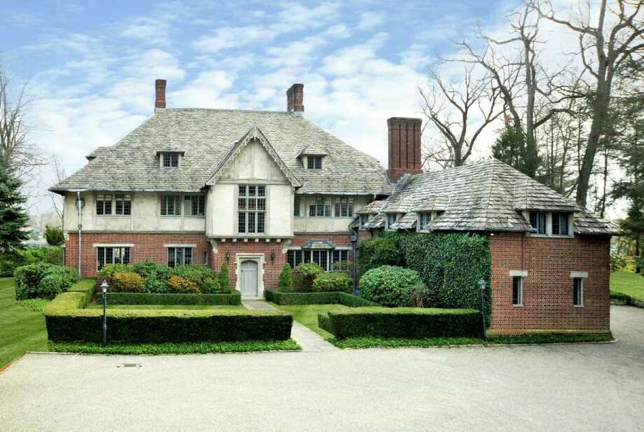 Set on more than 6.5 waterfront acres in Indian Harbor in Greenwich, this baronial Tudor was built for his family in 1928 by Isaac Newton Phelps Stokes, noted architect, historian and housing reformer. The elegant mansion of 9,100 square feet, has nine bedrooms, eight baths, two half-baths and eight fireplaces. There's an elevator, a generator and a three-car garage. The property has 800 feet of waterfront and a dock. Photo: Contributed Photo / Greenwich Time Contributed