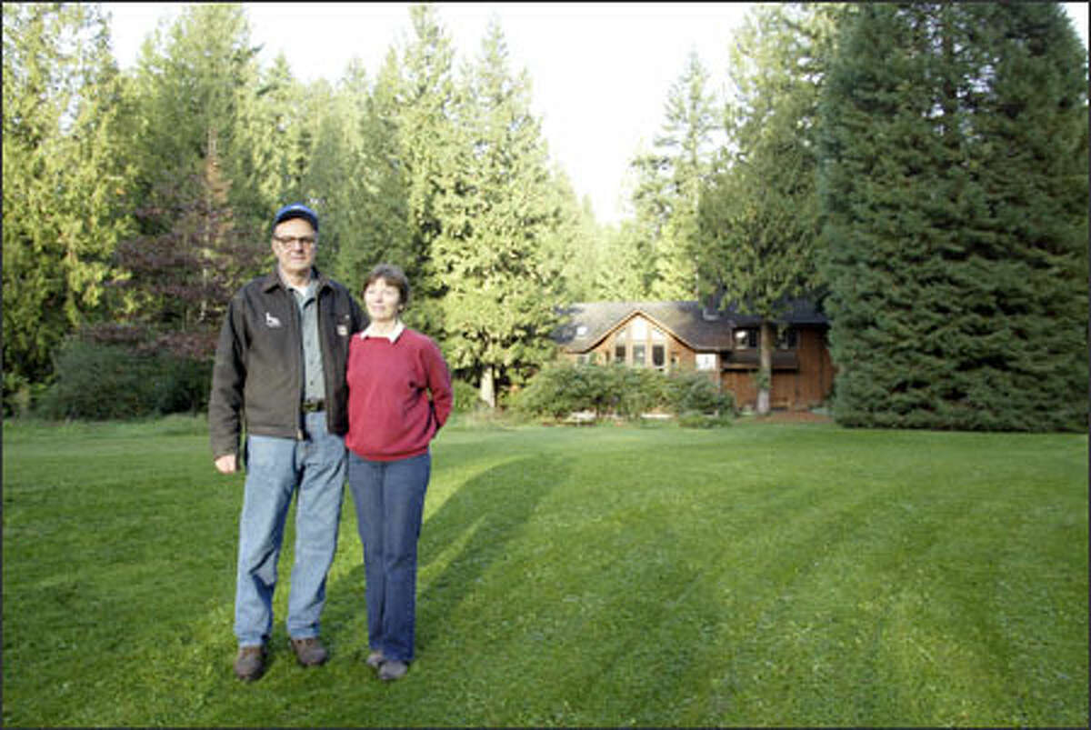 Karl Lechner of Stillwater, seen with wife, Diane, questions why stricter land-use regulations are necessary. The couple own 60 acres of land. Karl Lechner already has tangled with King County over building a garage.