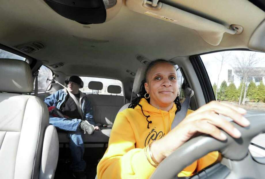 Transportation Association of Greenwich driver Janine Gerald gives a ride to client Matt Moss from a Greenwich location to his Stamford home as part of the Dial-a-Ride program, Riverside Avenue, Greenwich, Wednesday, March 16, 2011.  Jim Boutelle, executive director of the Transportation Association of Greenwich, said the proposal to cut TAG's funding by $2 million in the upcoming state budget could force Dial-A-Ride to be cut back. Photo: Bob Luckey / Greenwich Time