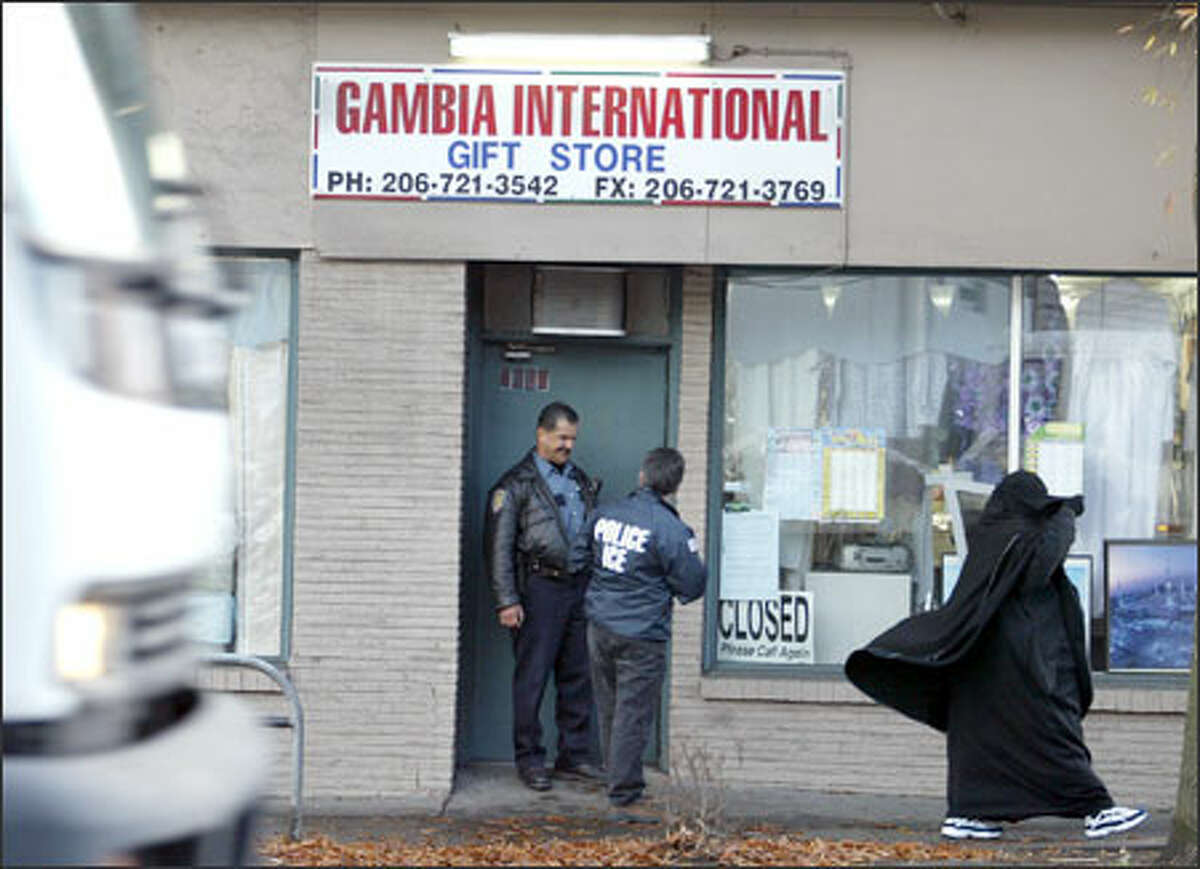 A multiagency task force took three men into custody after raiding the Gambia International Gift Store yesterday morning.
