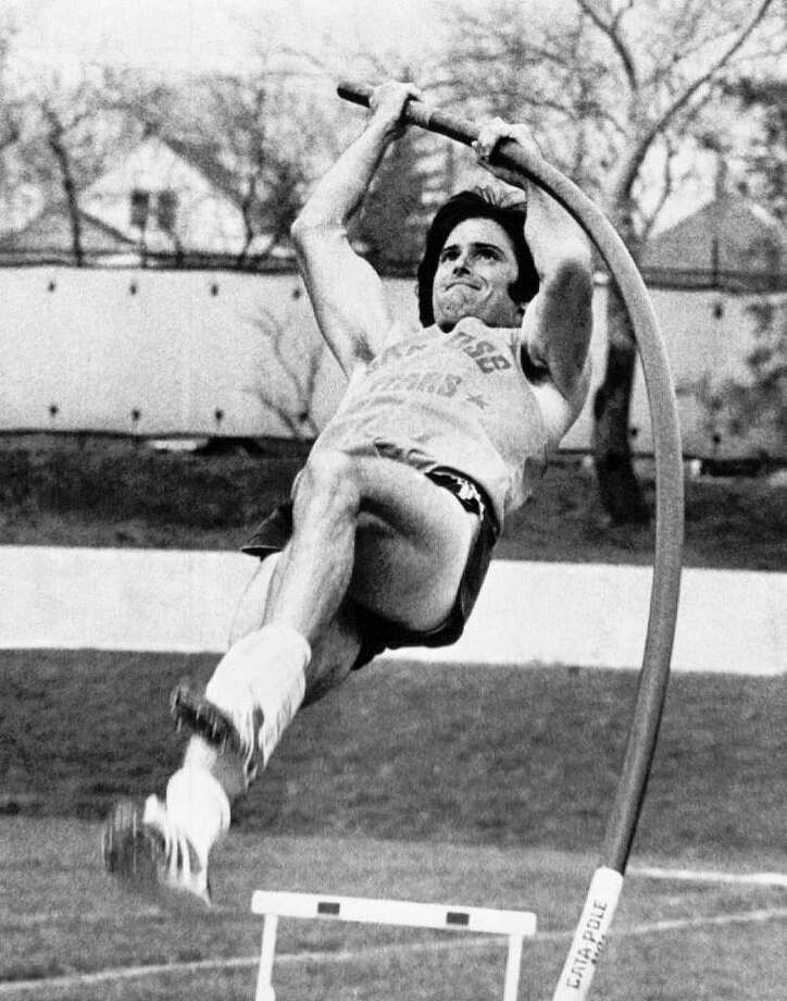 Bruce Jenner starts his upward climb in the pole vault during the final day's competition on Thursday, April 24, 1975 in the decathlon at the 66th drake relays in Des Moines, Iowa. Olympian Jenner, third going into the final five events, took the lead after nine events and capture the title with 8139 points - best scored recorded in the world this season. Jenner represents the San Jose stars. (AP Photo) Photo: Contributed Photo / The News-Times Contributed