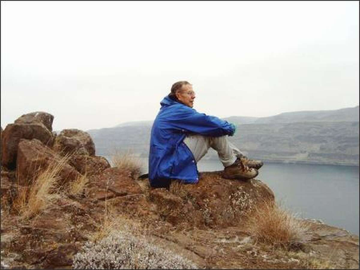 John Walenta of Seattle takes in the wide-open vista of the Columbia River from a high point along the Ginkgo Petrified Forest Backcountry Trail.