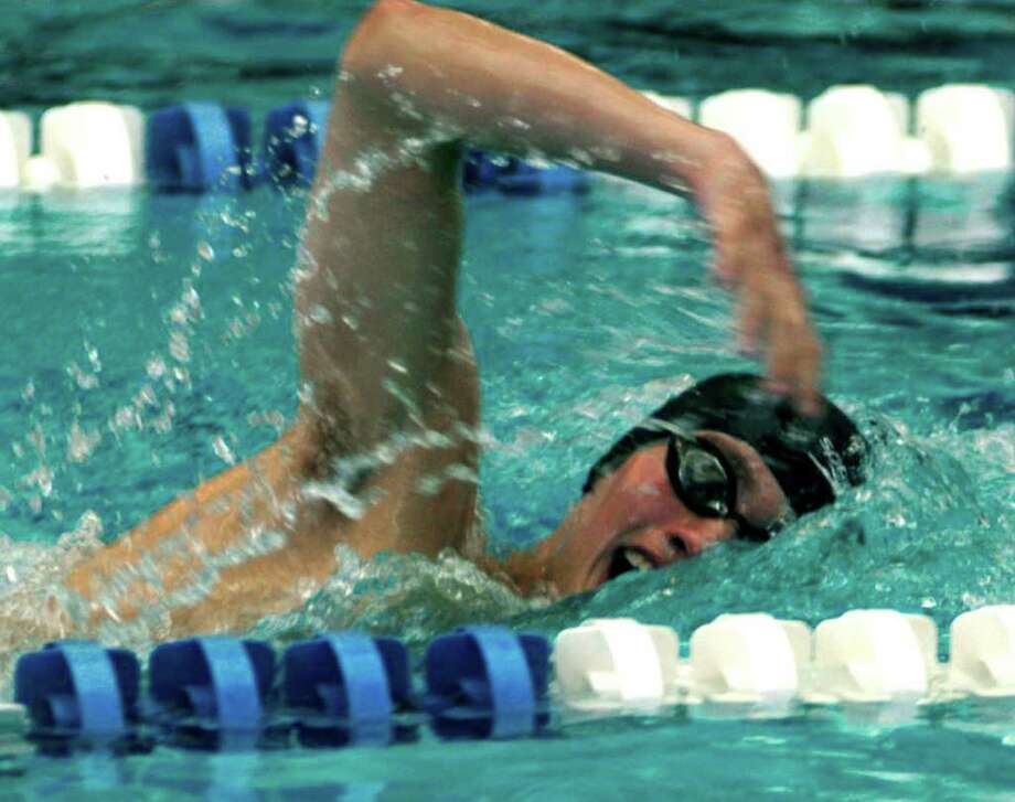 SPECTRUM/Griffin DeCaro of the Shepaug Valley High School swim team churns out the laps in the 500-yard freestyle race Saturday during the Berkshire League swim meet at Hotchkiss School in Lakeville. The Spartan standout was among the key contributors as coach Todd Dyer's Region 12 student-athletes romped to victory in the league meet to tie a neat bow around a successful defense of their Berkshire championship. For the story and more photos, see next Friday's Greater New Milfrd Spectrum. Photo: Norm Cummings / The News-Times