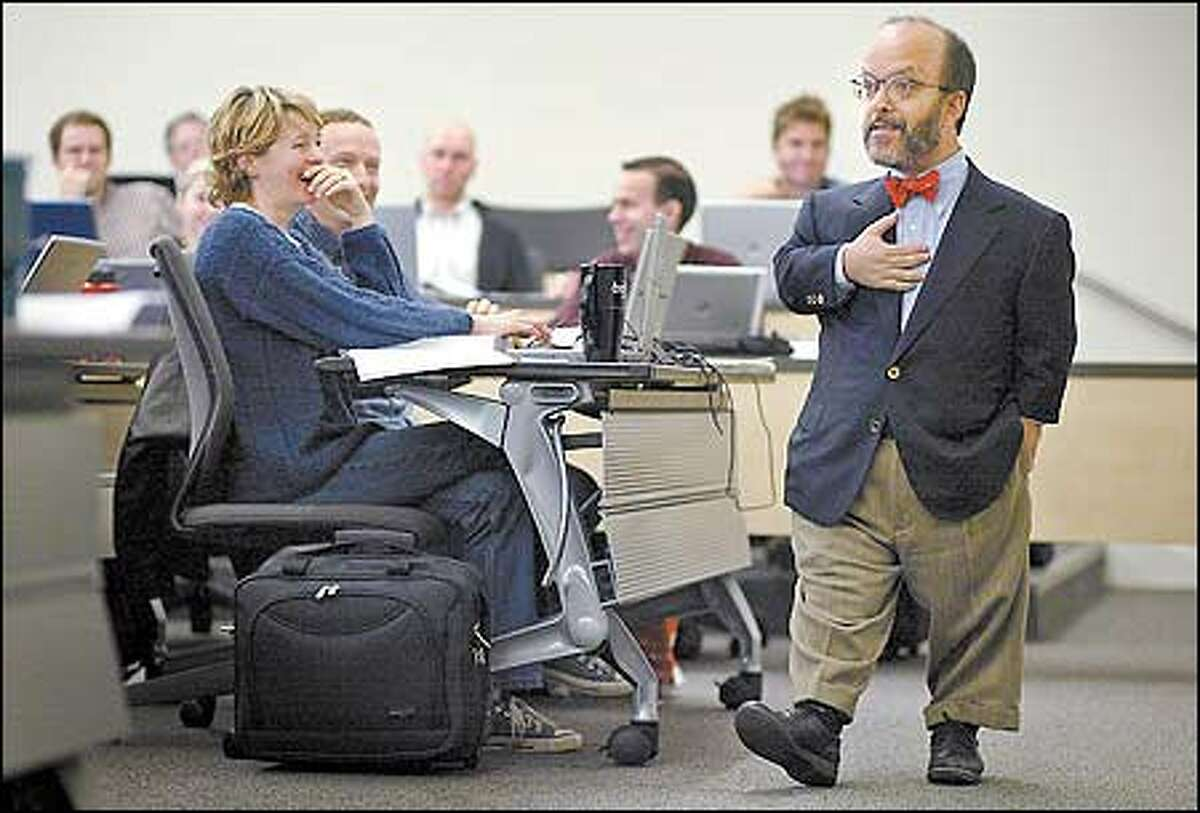 Lucy Arnold, front, laughs along with the rest of her tort class at the University of Washington as Professor Paul Steven Miller jokes with them.