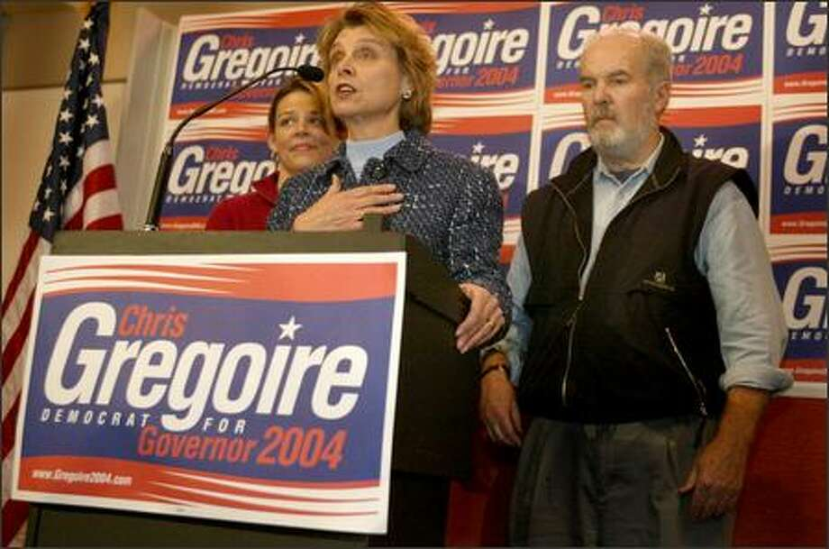 Governor candidate Chris Gregoire announces that she will ask for another recount of votes on Wednesday at Town Hall in downtown Seattle. She was joined by her daughter Courtney and former Governor Booth Gardner. Photo: Joshua Trujillo/Seattle Post-Intelligencer
