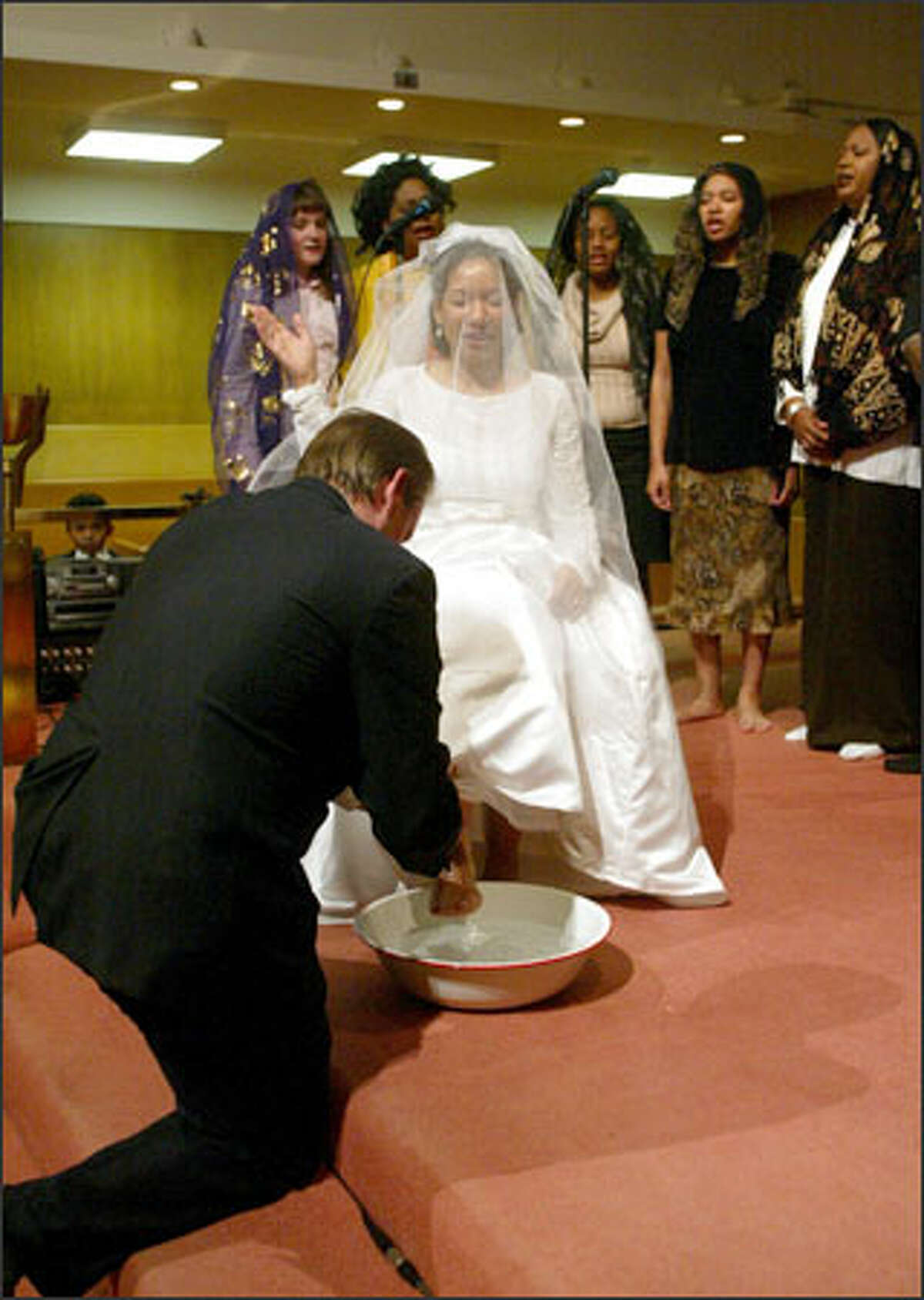 Brian Ostertag washes Susana Urbaez's feet during their Thanksgiving Day ceremony. Ostertag wanted to do this as a symbol of his love and of Christian humility.