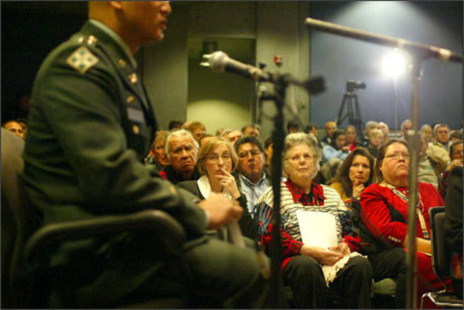 Capt. Paul Robson takes the witness stand during an exoneration trial for Chief Leschi at the Washington State History Museum, in front of two rows of witnesses. Photo: Karen Ducey/Seattle Post-Intelligencer