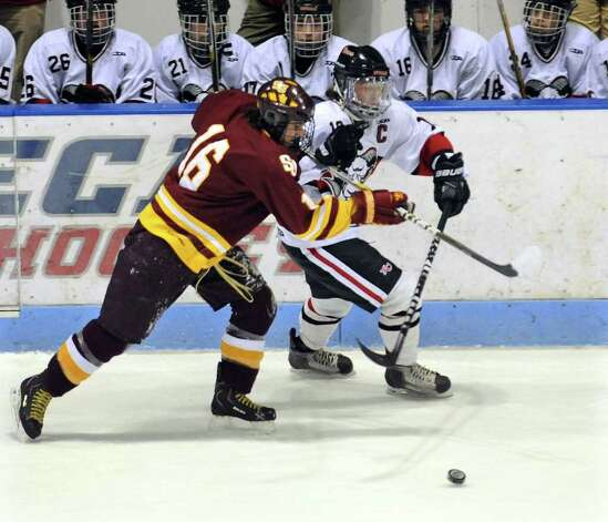 St. Joseph's #16 Matt Julian, left, cuts off New Canaan's #19 Reed Harper, during CIAC Class I semifinal boys hockey action at Yale's Ingalis Rink in New Haven, Conn. on Wednesday March 16, 2011. Photo: Christian Abraham / Connecticut Post