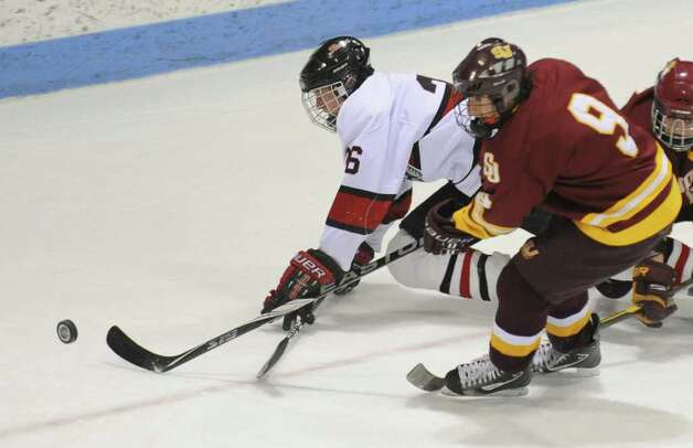 St. Joseph's #9 Christian Keator, right, and New Canaan's #26 Brock Anderson chase down the puck, during CIAC Class I semifinal boys hockey action at Yale's Ingalis Rink in New Haven, Conn. on Wednesday March 16, 2011. Photo: Christian Abraham / Connecticut Post