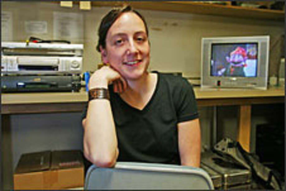 """University of Washington doctoral candidate Andrea Emberly will continue her research of """"Sesame Street"""" in South Africa next year. Photo: GILBERT W. ARIAS/P-I"""