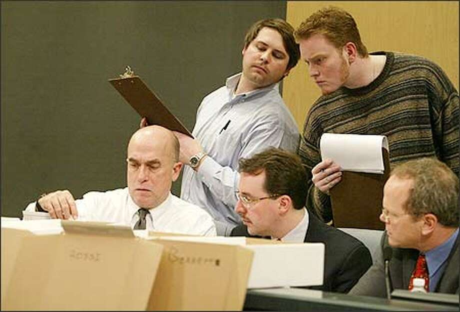 King County Councilman Dwight Pelz, Elections Director Dean Logan and Dan Satterberg of the prosecutor's office (L-R) examine a ballot while observers, Republican Steve Truebner, left, and Democrat Nigel Herbig, watch and record their decisions in the background. Photo: Meryl Schenker/Seattle Post-Intelligencer